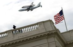 Space Shuttle Discovery, mounted atop a 747, flies over the U.S. Capitol on its way to permanent display at the Smithsonian National Air and Space Museum. (Win Mcnamee / Getty Images)