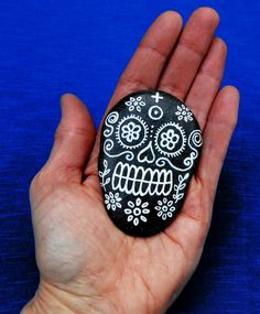 Day of the dead skull hand painted on beach by BenDyerOriginalArt