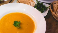 This is THE BEST slow cooker pumpkin soup around. With the cold weather suddenly taking hold, it's the perfect time for warm creamy pumpkin soup!