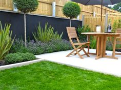 Ealing show garden with sandstone lower patio.