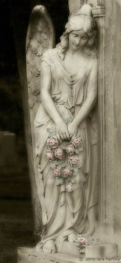angel with pink flowers