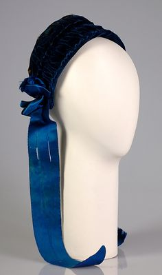 Blue silk velvet evening bonnet with feather and blue silk ribbon trim (front), American, ca. 1880.