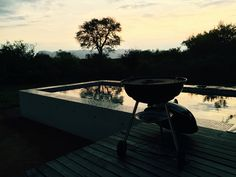 Your own South African braai in your private villa at sunset. Villablaaskans.co.za South African Braai, Charcoal Grill, Villa, Homes, Sunset, Outdoor Decor, Charcoal Bbq Grill, Sunsets, Houses