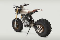 The Classified Moto Honda Big Wheel Monster is the brain child of John Ryland. Motos Honda, Honda Bikes, Honda Motorcycles, Custom Motorcycles, Custom Bikes, Cars And Motorcycles, Honda Dominator, Vintage Motorcycles, Mini Bike