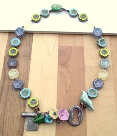 Key and bird necklace flower necklace statement by ButtonedUpBeads  $86