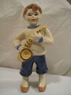 Ceramic Arts Studio Sax Boy. This item will be 25% OFF in the GVS Ruby Lane Sale Jan 12-13