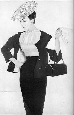1953 Dovima in navy blue high-waisted two-part dress of Irish tucked linen top with jacket by Talmack of Forstmann worsted crepe, photo by Irving Penn, Vogue, December