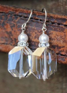 Jewelry Tip: Because they sparkle, crystal earrings bring luminosity to your face and make your eyes shine. This is a great way to bring attention and brightness to your face! www.ever-designs.com