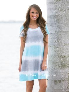 You will be forever joyful in this comfortable dress! The trendy tie dye pattern features shades of white, sky blue, and grey, while a scoopneck and short sleeves make this as comfortable as your favorite vintage t-shirt dress!