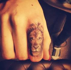 lion finger tattoo
