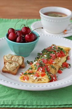 This Hummus and Feta Omelet is a filling, healthy and delicious low carb breakfast idea that's packed with protein and full of fresh and tasty flavor. Just 279 calories  or 7 Weight Watchers points! www.emilybites.com