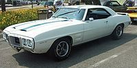 """Originally the car was a """"consolation prize"""" for Pontiac, who had initially wished to produce a two-seat sports car of its own design, based on the originalBansheeconcept car. However, GM feared such a vehicle would directly compete with Chevrolet'sCorvette, and the decision was made to give Pontiac a piece of the pony car market by having them share theF-bodyplatform withChevrolet."""