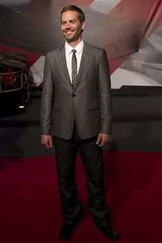 """Paul Walker poses for photos at the premiere of """"Fast Five"""" in Rio de Janeiro, Brazil, on April 15, 2011."""
