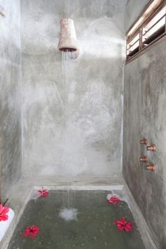 Casa Lola, Brazil-'The shower in the guest cottage has a wooden shower head made from a fallen tree, and copper faucet knobs made by local artisans.'