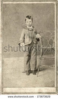 CIRCA 1865 - A vintage Cartes de visite photo of a young boy standing next to a chair. A photo from the Civil War Victorian era. A digital copy of this photo can be purchased at the above web link.