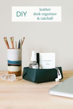 Tidy up your desk with a super easy DIY Leather Desk Organizer and Catchall! Learn how to make one from a single piece of leather + instructions for how to monogram or personalize your handmade container!