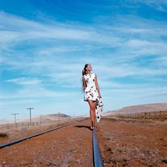 Veruschka photographed in the Alpine Basin of Texas wearing a Dalmation-spotted culotte dress and jacket by Originala. Photographed by Franco Rubartelli for Vogue, 1968.