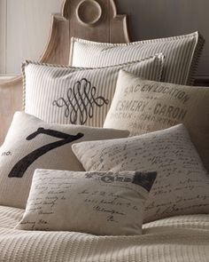 Pillows by French Laundry Home at Horchow.  This is the sort of thing I want to DIY with fine and rough linen fabrics and image transfer method or stencil & paint.