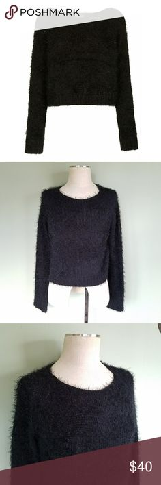 Topshop Knitted Fluffy Crop Sweater Topshop. Women's 10.  Knitted all-over fluffy stitch crop jumper. Color- Black 80% acrylic, 20% nylon.  Machine washable.  Luxuriously soft and cozy.  Excellent condition! Style idea- Pair it with high waisted jeans and booties, layer it over your favorite dress, or top it with an oversized cardigan. Topshop Sweaters Crew & Scoop Necks