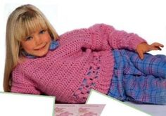 This sweater is beautiful finished and it is a simple pattern.  Great for the little girl (or boy) in your life.