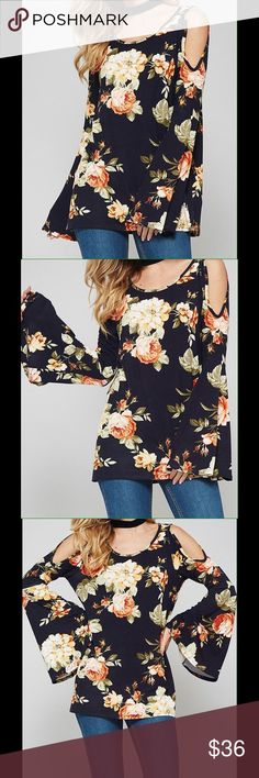 Navy Floral Print Cold Cut Out Shoulder Tunic Top Navy floral print bell sleeve tunic top with cut out shoulder. Flattering rounded neckline, flare long sleeves, and long enough to cover the areas you may want covered. Fabric has a good amount of stretch. 95% polyester and 5% spandex. Made in the USA. 🇺🇸 Please ask for measurements. Flying Daisy Tops Tunics