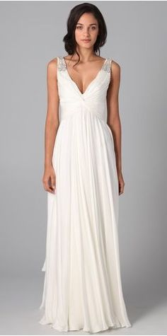 Embellished V-Neck Gown  $5,060  Romantic without feeling overdone, this ivory silk gown from Reem Acra has jeweled straps and a twist detail at the pleated bodice. The draped skirt plays to easy, elegant motion and the V neckline adds to the simple sophistication.