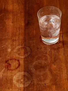 Water Rings on Wood... Set a cold drink on your wood furniture without using a coaster and you'll leave a round reminder not to do it again. To remove it, dip a white cloth in a mixture of equal parts vinegar and vegetable oil, and rub out the stain, wiping with the grain. Then clean the area with a dry cloth to make the wood shine. You can also remove water rings from leather furniture by dabbing them with vinegar on a cloth.