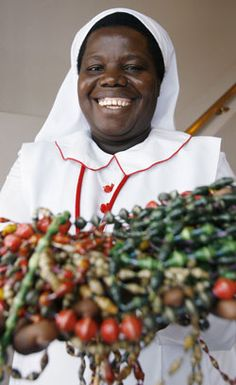 Sister Rosemary Nyirumbe, a member of the Sisters of the Sacred Heart of Jesus, displays strings of paper beads made by students at her school located outside Gulu in northern Uganda. For her efforts in educating outcast youths and those affected by war, she was named a 2007 CNN Hero by the cable broadcaster.