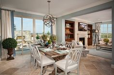 A sunny dining room opens to a patio and outdoor fireplace and to an adjoining great room. Residence Three by Pulte Homes. The Latitude new home community. San Diego, CA.