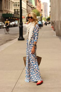 brilliant red shoes peeking out from under the blue dress and cream scarf...love.