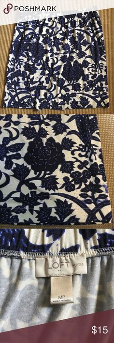 """Loft blue floral skirt Loft Petite Medium navy, blue and white floral print skirt. Hit me above the knee. Length is 19"""". Has as elastic waistband that is 15"""" across unstretched. Entire skirt has quite a bit of stretch since it's 94% Rayon, 6% spandex. Excellent condition, wore once or less (can't remember wearing it). LOFT Skirts Mini"""