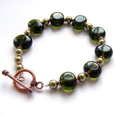 Lampwork bead bracelet made from recycled wine bottle glass (Chianti), swarovski pearls and copper