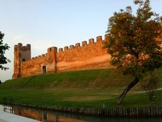 #Castelfranco #Veneto, #Giorgione's birthplace, welcomes you with its fine medieval walls. You may visit the walls around the castle and then the cathedral to admire the painter's masterpiece, a Madonna enthroned with saints.