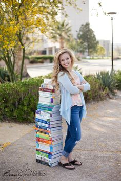 Nursing student with ALL of her books! A good way to remember all the hard work you put in! {class of 2014}