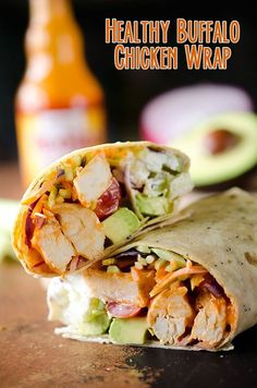 Healthy Buffalo Chicken Wrap - A light and healthy wrap filled with buffalo chicken breasts, Greek yogurt, bleu cheese crumbles, broccoli slaw, avocado and tomatoes for an easy lunch with bold flavor!