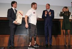 Prince William applauds as Max Worsley (lef) and Alicia Worsley (right) award Neil Heritag...