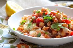 Slow-Cooker Chickpea Stew with ApricotsYields: 6 servings 2 (15oz) cans chickpeas/garbanzo beans, drained and rinsed 1 (28oz) can diced tomatoes 1 (15oz) can chicken broth 3T butter 1 onion, finely chopped 3 cloves garlic, minced 3/4c turnip, peeled and chopped 1/2c dried apricots, chopped (I used Turkish dried apricots) zest of 1 lemon 1t cumin 1/4t ground coriander 1/2t salt 1t sugar pinch of cayenne pepper (or more to taste) For Serving: cilantro, chopped lemon wedges