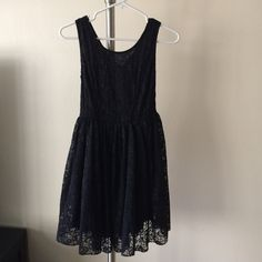 Anthropologie Stone Flower Black Lace Dress Stone Flower brand from Anthripologie. Lightly worn, in excellent condition. Scoop neck front, v back. Hidden side zip. 100% polyester. Tag does not have size printed but should be size S. Anthropologie Dresses