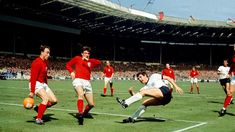 - West Germany's Lothar Emmerich (fourth l) fires a shot past England's George Cohen (l) and Martin Peters (second l) as England's Bobby Charlton (third l), Nobby Stiles (fifth l) and Roger Hunt (sixth l) look on Retro Football, World Football, Vintage Football, Sport Football, Women's Cycling Jersey, Cycling Jerseys, Banks, 1966 World Cup Final, Bobby Charlton