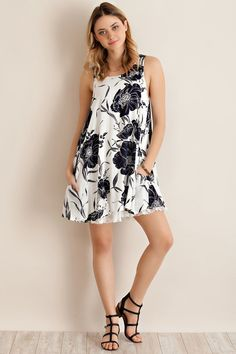 Entro USA Floral Tours Dress - Entro USA Flower Print A-Line Dress  Dress it up or down  Pair with boots, heels, or sandals - great transitional piece  Full slip attached with lace bottom - non-sheer  Side pockets, keyhole back closure  Material - lining -100% poly dress - 100% rayon