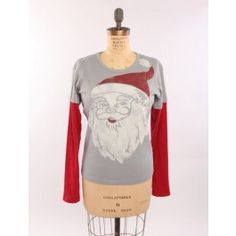 Everyone loves Santa, so why not make a statement with this fun, festive and retro Santa shirt? Our double-up gives the appearance of the layered look in one easy shirt. Our screen and dye processes are water based and environmentally friendly. Form flattering women's cut; 100% organic cotton; pre-shrunk; knit, cut and sewn in the USA!