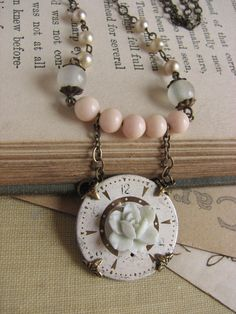 Pretty and pastely. ~Shabby Chic Watch Face Assemblage Necklace -repurposed vintage, Steampunk, peach, mint rose. $40.00, via Etsy.