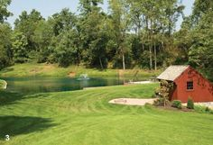 A pond dots a meadow alongside this quaint red bank barn outbuilding in Lititz, PA owned by Garman Builders' Vice President Shawn Garman. Photography by Eric Forberger.