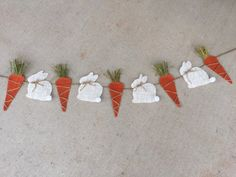 This adorable burlap Easter bunny & carrot banner is made with bunnies and carrots. The bunnies have the cutest little fluffy tail and twine bow! The carrots have green raffia at he top. *****All orders placed by March 15 will arrive in time for Easter! *****  This banner is available in a variety of sizes. 37.5 inches is 7 items, 4 carrots 3 bunnies. 47 is 9 and 58 is 11. Total size of the each bunny is approx 5 wide and each carrot is 3 wide at the top. They are sewn to twine for hanging…