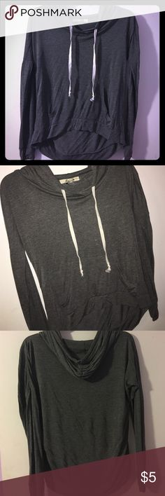 Juniors hooded top. Cute simple casual women's hooded top. Long sleeve. Excellent condition. Never worn. Tag says medium but runs small. Would be best for XS or if you wish to wear as crop hoodie lightweight shirt. Tops