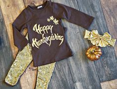 Up to 73% off retail! Thanksgiving is around the corner! If you have a little girl that likes to outshine the crowd, then she'll love this sparkly outfit! Features a gold foil graphic tee and sequin faced leggings. Complete the look by adding on the matching headband for just $5.00. Available Sizes (we recommend you order up if closer to the end of a size): 12-18 months 2T 3T 4T 5 6/6X 7/8 10/12 Best Price Alert: When you share and save an extra 10%, the pant set is just $13.50 and ...