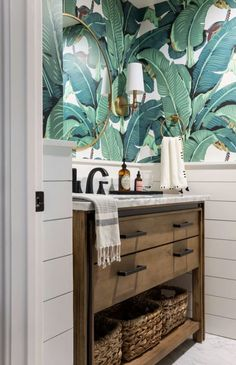 I had so much fun designing this modern farmhouse home in San Jose! This couple wanted a farmhouse look with Spanish and Hawaiian elements, and it turned out beautifully. I designed the bathroom with a Hawaiian theme with tropical leaf wallpaper and a wooden vanity with straw woven baskets. See more of this modern tropical bathroom transformation on my site! Modern Bathroom Decor, Bathroom Designs, Bathroom Ideas, Powder Room Design, Hawaiian Theme, New England Homes, Bird Wallpaper, Bedroom Images, Ship Lap Walls