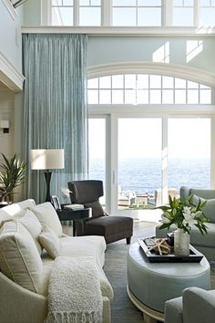 Living room with picture window, Arched window above regular window with another set of windows even higher and curtain rod that borders the bottom line of top windows