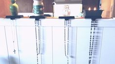 Use stocking holders to hang rosaries all year long.