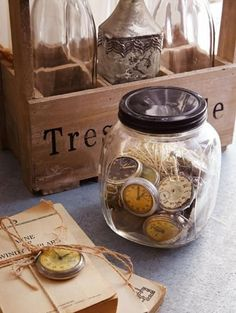 Old pocket watches from a flea market provide a tabletop accent. More ideas for decorating with vintage finds: www.midwestliving...